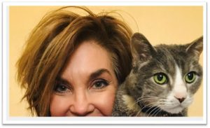 Photo of Annette with her cat Tippy