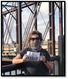 Photo of Annette on a bridge at a running race