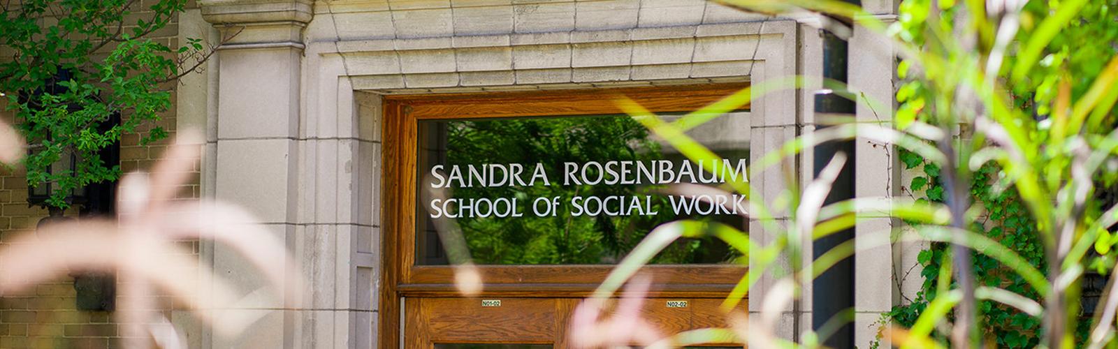 Photo of entrance with name: Sandra Rosenbaum School of Social Work stenciled on door